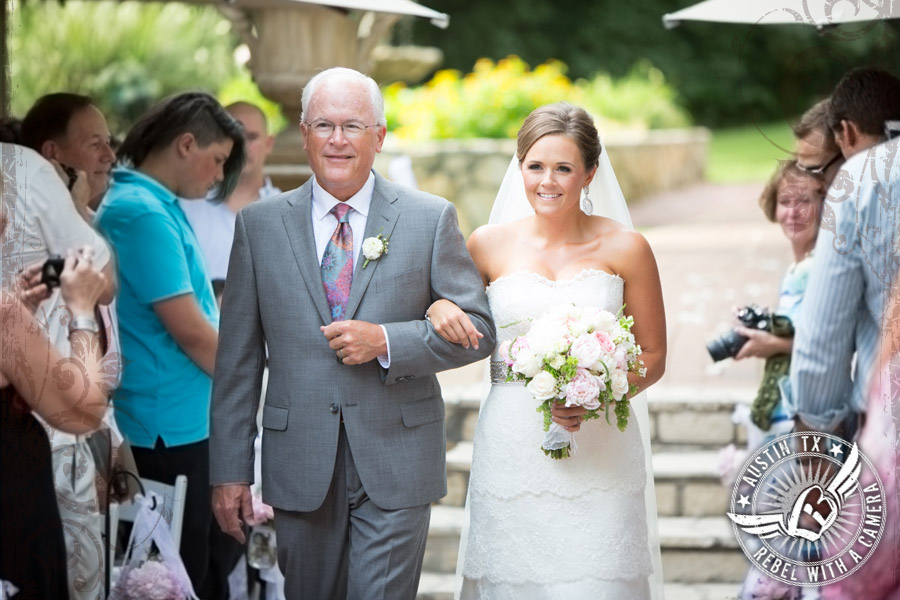 Bride and her dad walking down the aisle at Nature's Point