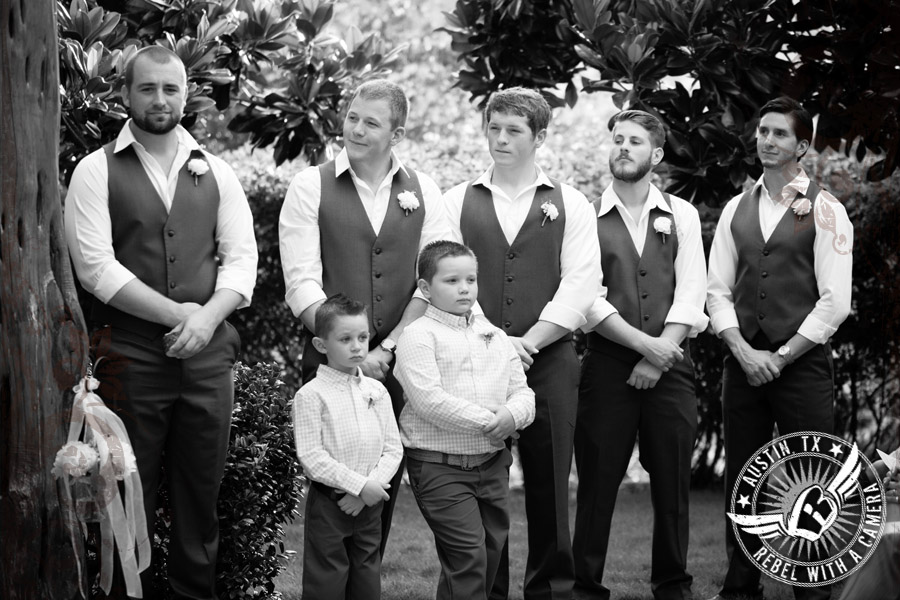 Groomsmen look on during ceremony at Nature's Point