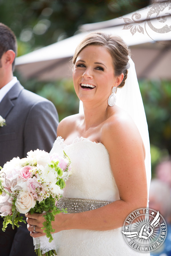 Bride laughs during ceremony at Nature's Point