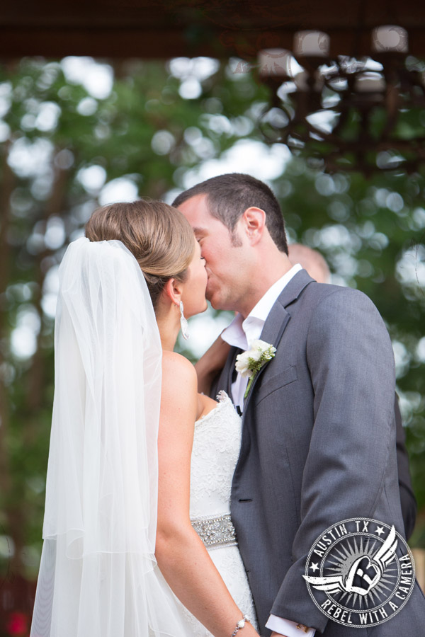 Bride and groom's first kiss at Nature's Point
