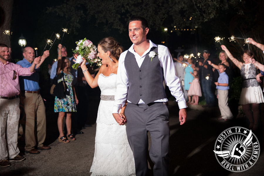 Bride and groom sparkler sendoff at Nature's Point wedding venue