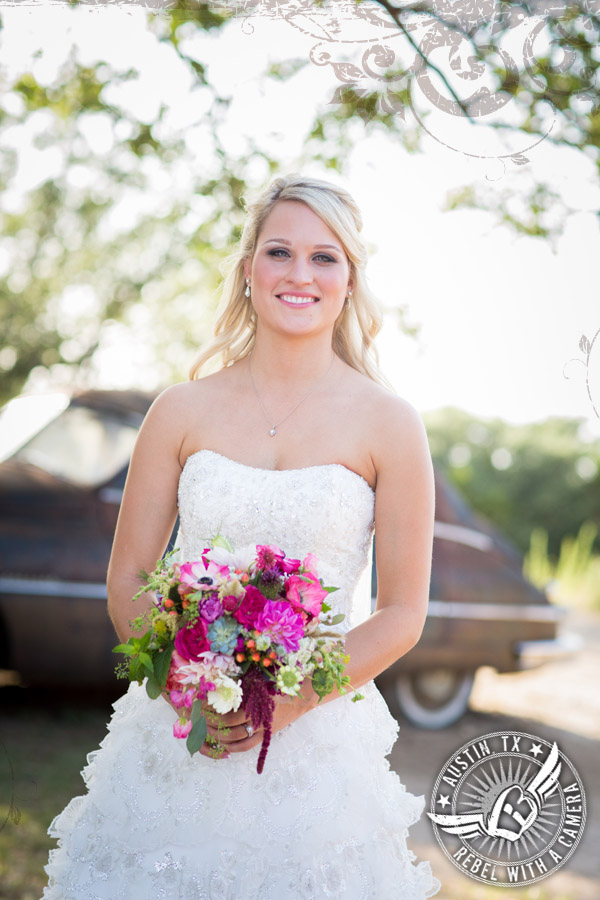 Gorgeous bride with bouquet by Petal Pushers at Vista West Ranch