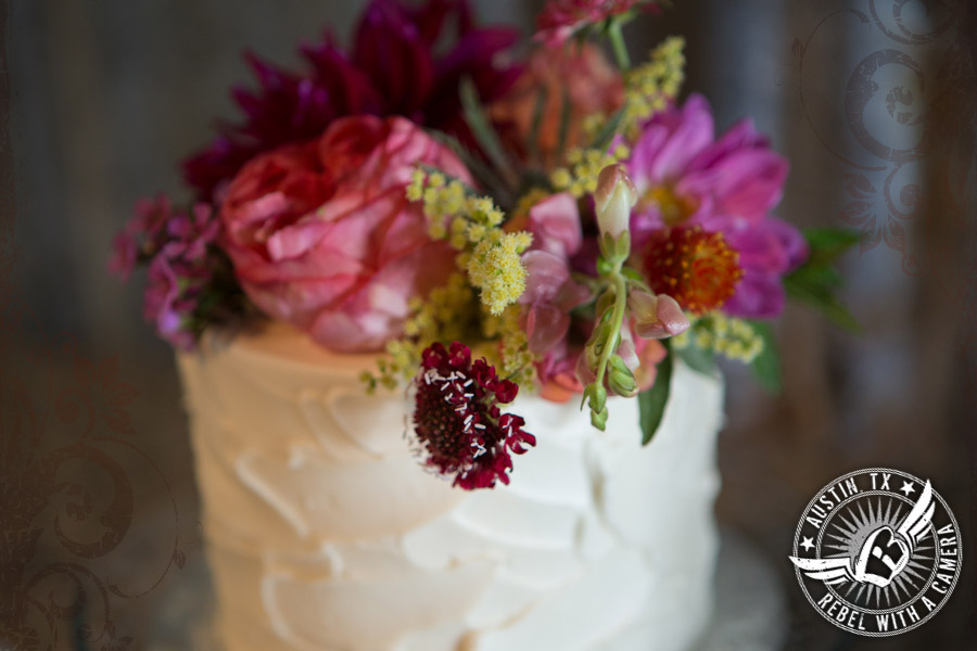 Wedding cake by Sweet Treets Bakery with floral cake topper from Petal Pushers at Vista West Ranch