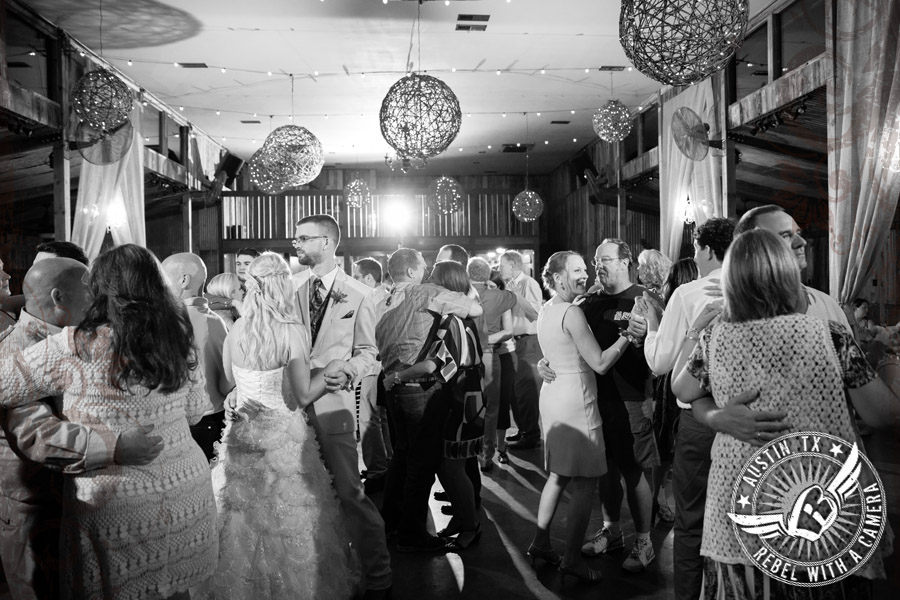 Guests dance at wedding reception at Vista West Ranch