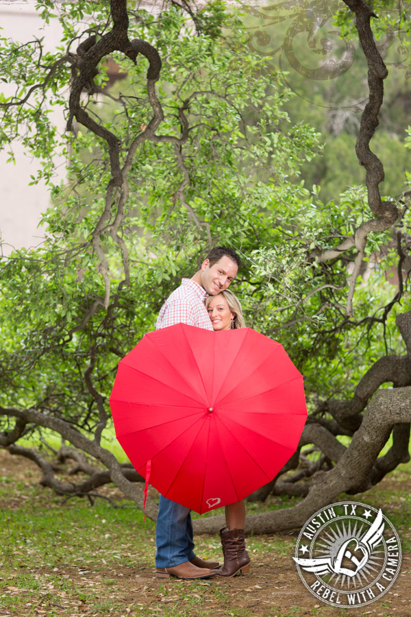 Downtown Austin engagement portraits with a red umbrella