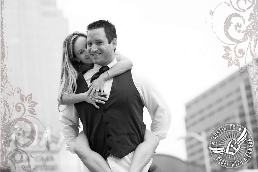 Downtown Austin engagement portraits piggy back ride