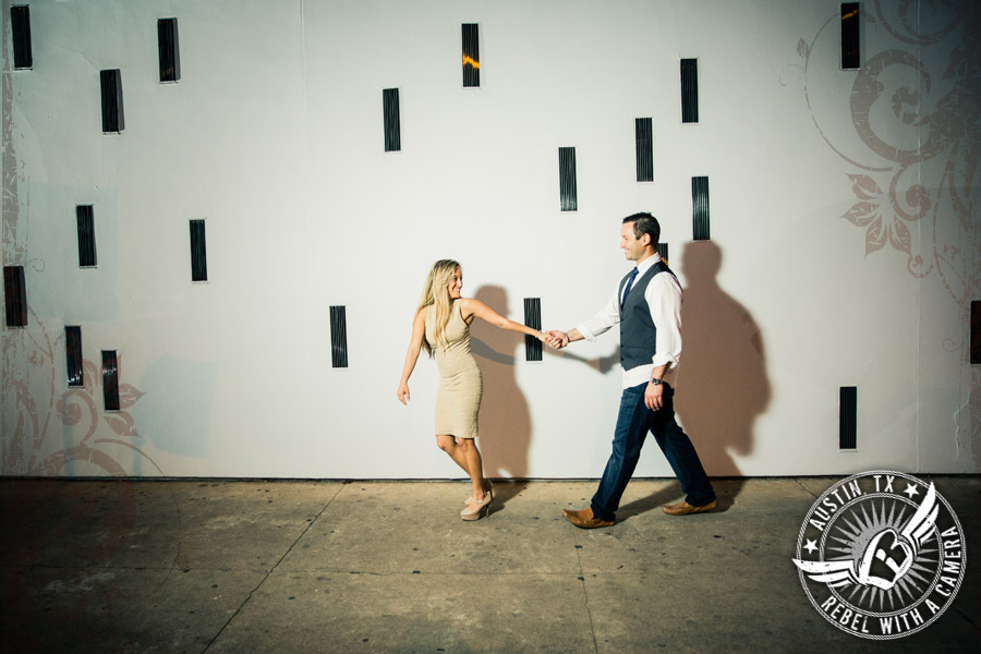 Downtown Austin engagement portraits walking by the Contemporary Austin Art Museum