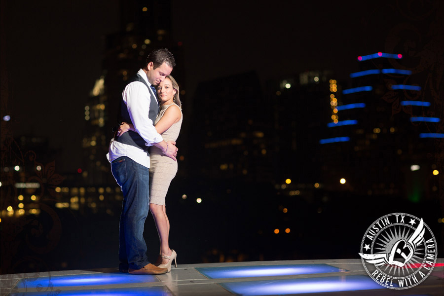 Downtown Austin engagement portraits romantic embrace in front of the skyline