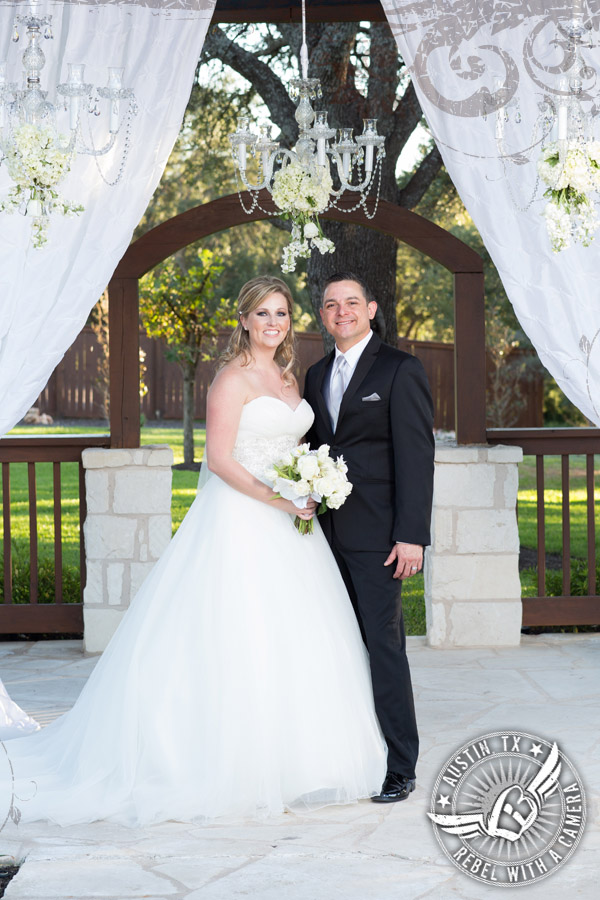 Bride and groom at arbor in wedding pictures at Gabriel Springs Event Center in Georgetown, Texas