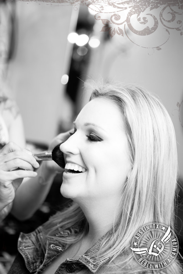 Bride gets makeup done at Gabriel Springs Event Center in Georgetown, Texas