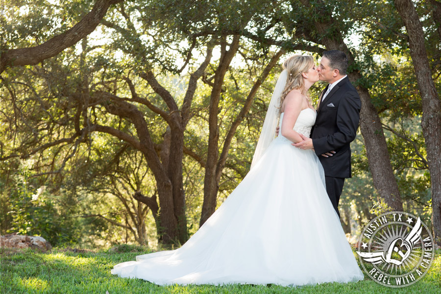 Kissing bride and groom at Gabriel Springs Event Center in Georgetown, Texas