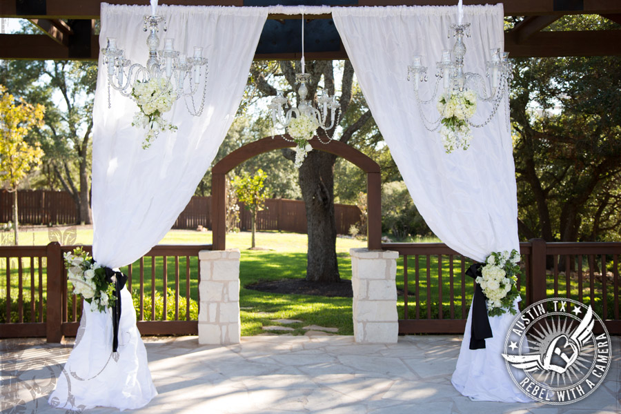 Rustic glam wedding arbor by Brenda Abbott Floral Design at Gabriel Springs Event Center in Georgetown, Texas