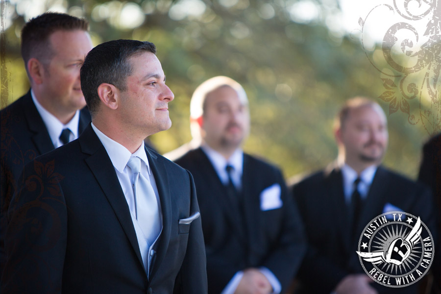 Groom sees his beautiful bride during wedding ceremony at Gabriel Springs Event Center in Georgetown, Texas