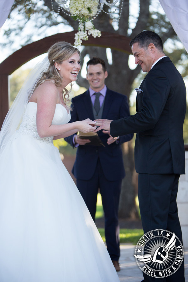 Laughing bride and groom at wedding ceremony at Gabriel Springs Event Center in Georgetown, Texas