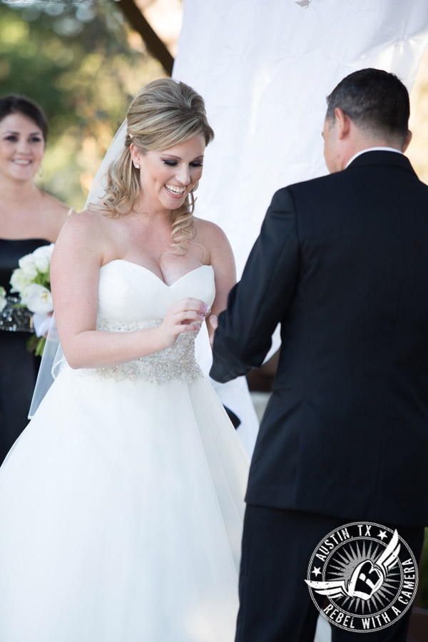 Ring exchange during wedding ceremony at Gabriel Springs Event Center in Georgetown, Texas