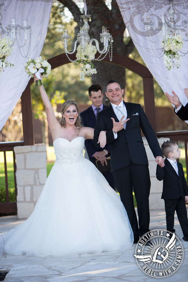 Happy couple walks down the aisle at Gabriel Springs Event Center in Georgetown, Texas