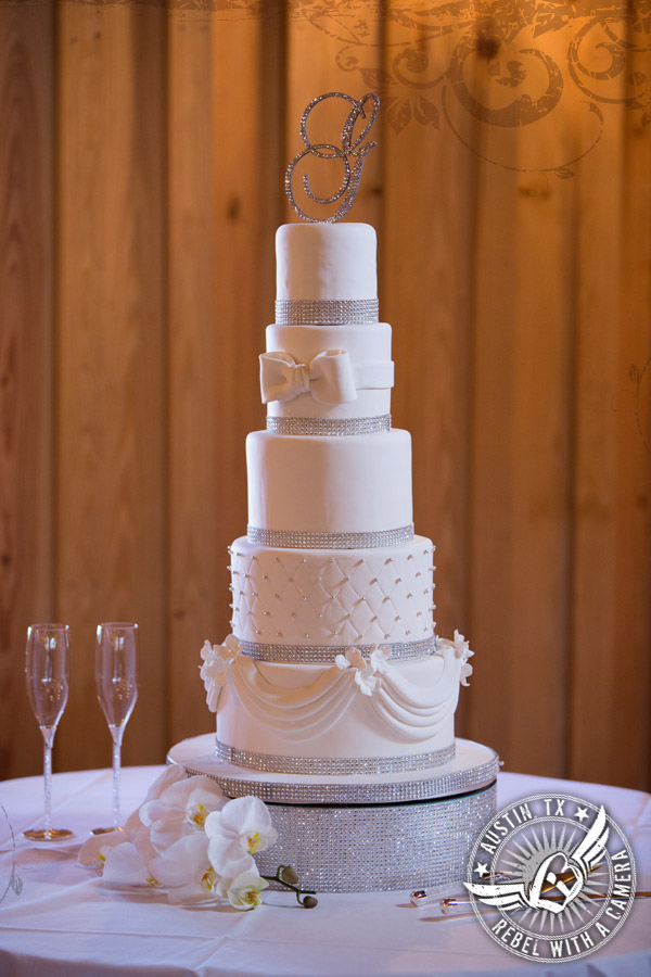 Glamorous white wedding cake by Simon Lee at Gabriel Springs Event Center in Georgetown, Texas