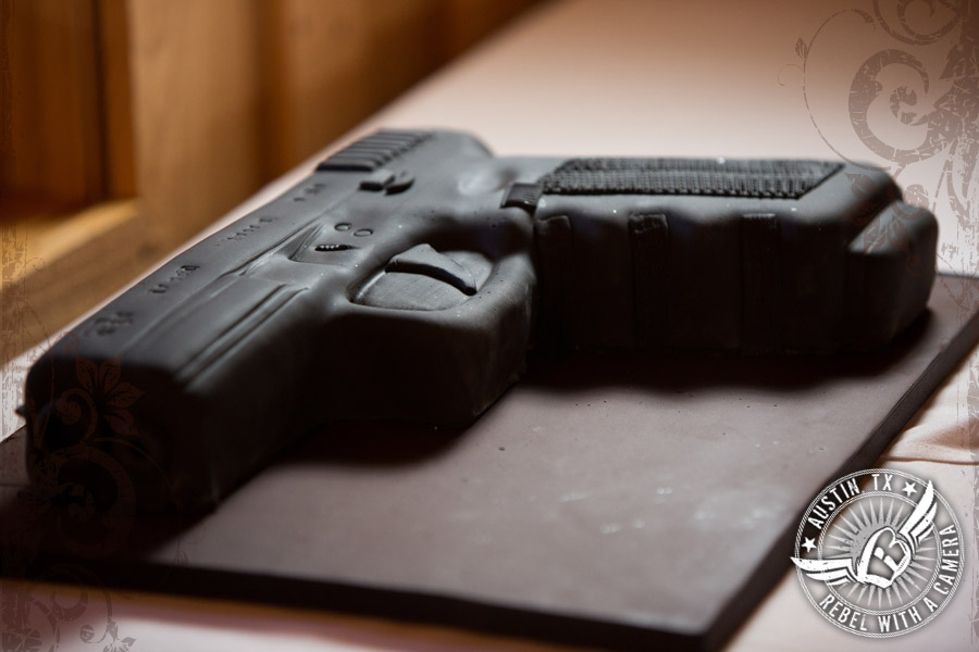 Glock groom's wedding cake by Simon Lee Bakery at Gabriel Springs Event Center in Georgetown, Texas