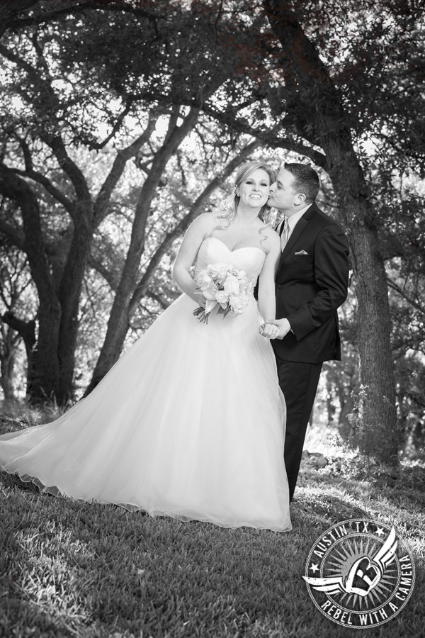 Groom kisses bride at Gabriel Springs Event Center in Georgetown, Texas