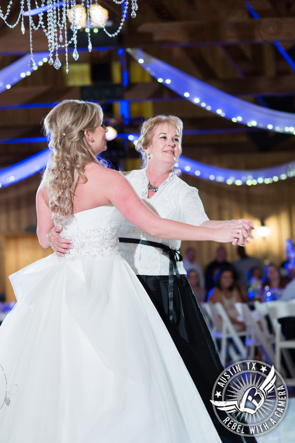 Bride and mother dance at wedding reception at Gabriel Springs Event Center in Georgetown, Texas