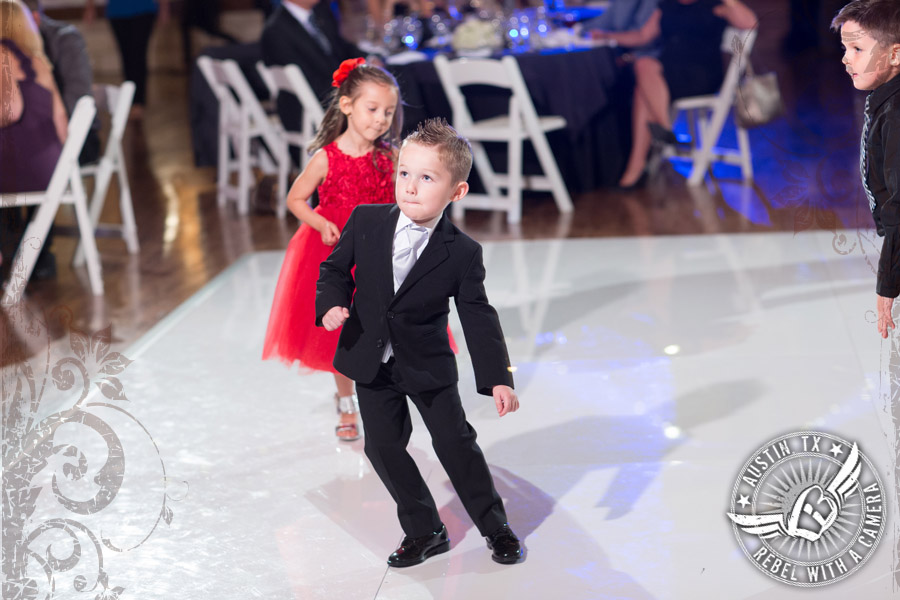 Ring bearer dances at wedding reception at Gabriel Springs Event Center in Georgetown, Texas