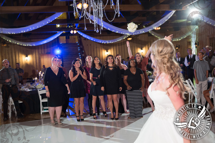 Bride throws the bouquet at Gabriel Springs Event Center in Georgetown, Texas