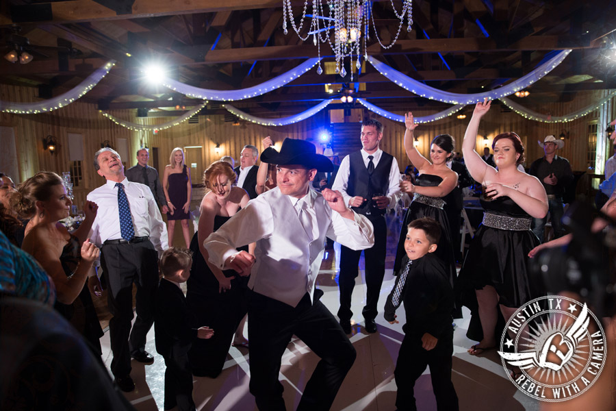 Groom dances during the wedding reception at Gabriel Springs Event Center in Georgetown, Texas