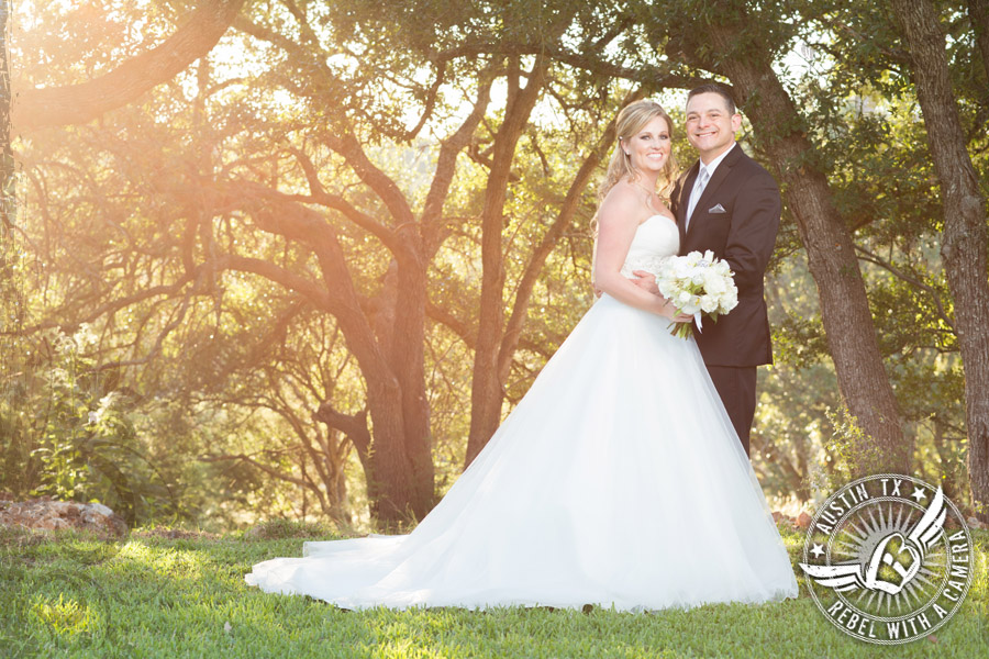 Smiling bride and groom in wedding pictures at Gabriel Springs Event Center in Georgetown, Texas