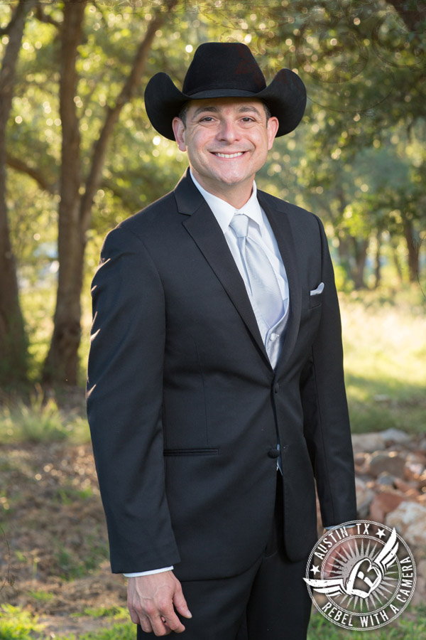 Groom in cowboy hat in wedding pictures at Gabriel Springs Event Center in Georgetown, Texas